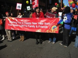 Pauline Park with LGBT banner